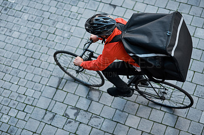 Buy stock photo Shot of a delivery man out with his bicycle
