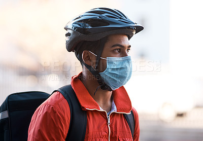 Buy stock photo Cropped shot of a delivery man wearing a mask