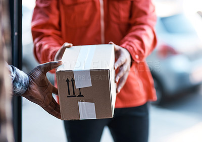 Buy stock photo Cropped shot of a delivery man handing over a package