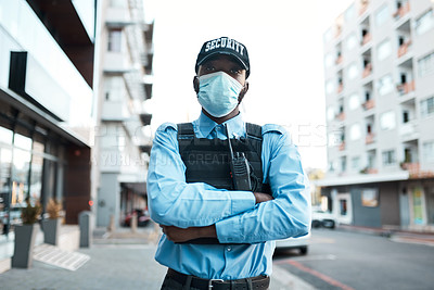 Buy stock photo Portrait of a confident masked young security guard standing guard outdoors