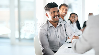 Buy stock photo Shot of a young businessman shaking hands with a colleague during a meeting in a boardroom