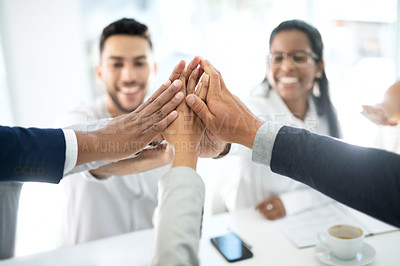 Buy stock photo Closeup shot of a group of unrecognisable businesspeople joining their hands together in a huddle in an office