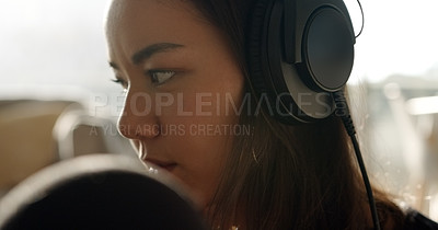 Buy stock photo Shot of a young woman recording recording music from her home studio