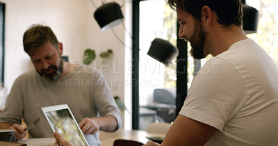 Buy stock photo Shot of a mature couple having breakfast and using a laptop at home