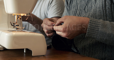 Buy stock photo Shot of an unrecognisable couple making face masks at home