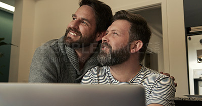Buy stock photo Shot of a mature couple using a laptop while working at home