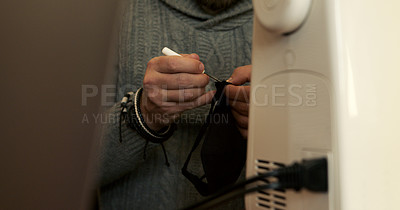 Buy stock photo Shot of an unrecognisable man making making face masks at home