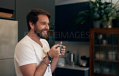 Buy stock photo Shot of a mature man having coffee in the kitchen at home
