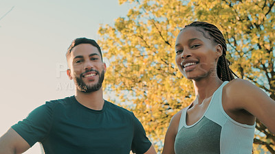 Buy stock photo Shot of a fit young couple out at the park for their workout
