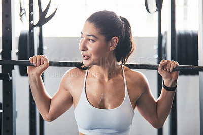 Buy stock photo Cropped shot of a young woman working out with a barbell at the gym