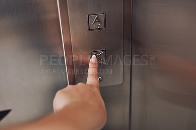 Buy stock photo Cropped shot of a woman pressing a button in an elevator