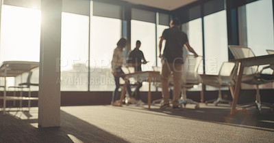 Buy stock photo Defocused shot of a group of businesspeople walking into a boardroom together