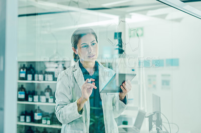 Buy stock photo Shot of a scientist using a digital tablet while solving equations on a glass screen in a laboratory