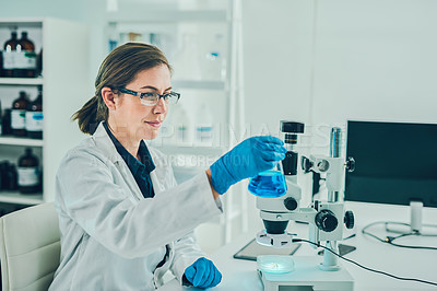 Buy stock photo Shot of a scientist conducting research in a laboratory