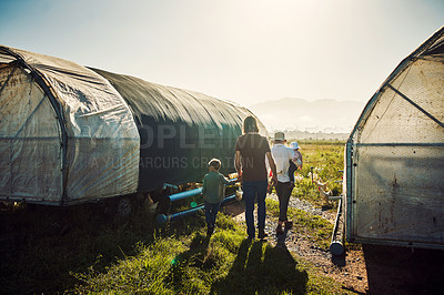 Buy stock photo Shot of a family spending time together on their farm