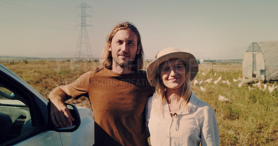 Buy stock photo Portrait of a young couple standing together on their farm