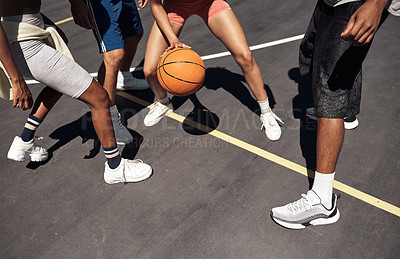 Buy stock photo Closeup shot of a group of sporty young people playing basketball on a sports court