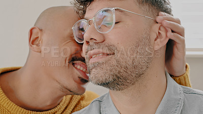 Buy stock photo Shot of an affectionate young couple relaxing together on the sofa at home