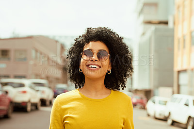 Buy stock photo Shot of a young woman looking happy while out in the city
