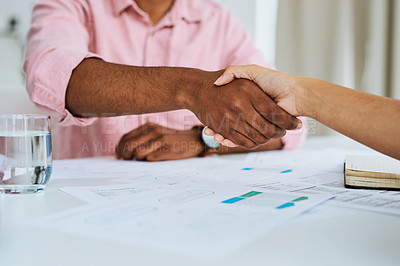 Buy stock photo Closeup shot of two businesspeople shaking hands during a meeting in an office