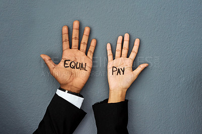 Buy stock photo Shot of a businessman and businesswoman advocating for equal pay against a grey studio background