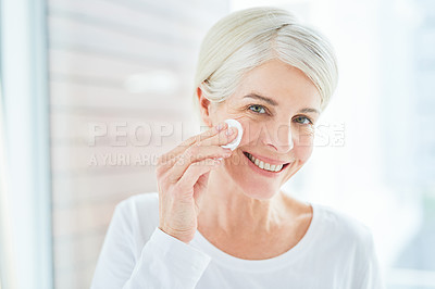 Buy stock photo Portrait of a mature woman using a cotton pad on her face