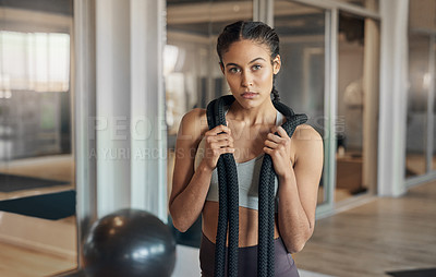 Buy stock photo Shot of a young female athlete posing with a rope around her neck
