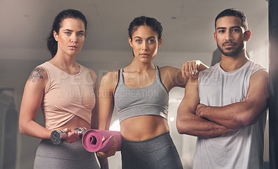 Buy stock photo Cropped shot of three young athletes standing together at the gym