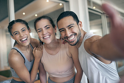Buy stock photo Cropped portrait of three young athletes taking selfies while standing in the gym