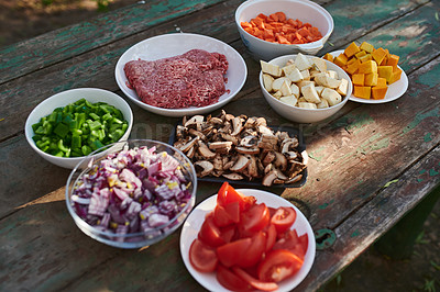 Buy stock photo Shot of various ingredients ready to be cooked at a barbecue outdoors