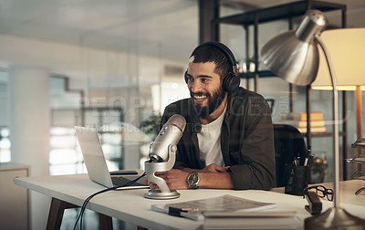 Buy stock photo Shot of a young man using a headset, microphone and laptop during a late night at work