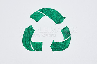 Buy stock photo Shot of a green recycle symbol painted on a wall