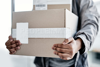 Buy stock photo Cropped shot of a man delivering a package to a place of residence