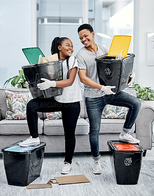 Buy stock photo Shot of a young couple recycling their trash at home