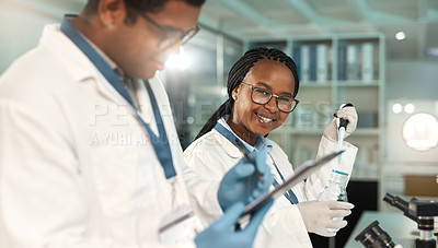 Buy stock photo Portrait of a young scientist working alongside a colleague in a lab