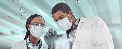 Buy stock photo Shot of two scientists drawing molecular structures on a glass wall in a lab