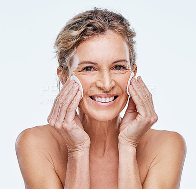 Buy stock photo Shot of a mature woman holding cotton pads against her face