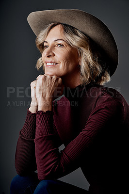 Buy stock photo Cropped shot of a mature woman looking stylish against a grey background