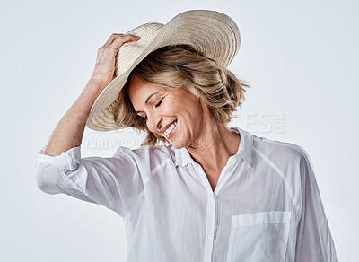Buy stock photo Cropped shot of a mature woman looking stylish against a white background