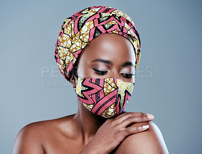 Buy stock photo Studio shot of a beautiful young woman wearing a mask against a grey background
