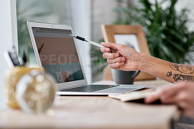 Buy stock photo Shot of an unrecognisable man using a laptop while working from home