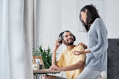 Buy stock photo Shot of a happy young couple working from home