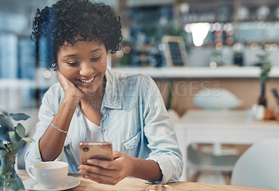 Buy stock photo Cropped shot of a woman using her cellphone while sitting in a cafe