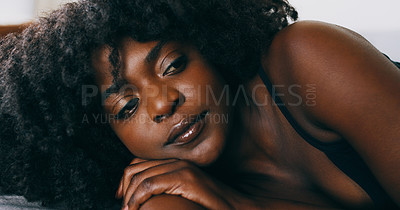 Buy stock photo Shot of a young woman relaxing in bed at home