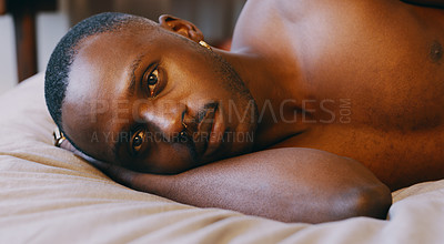 Buy stock photo Shot of a young man relaxing in bed at home