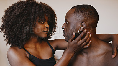 Buy stock photo Shot of an affectionate young couple sharing an intimate moment in bed at home
