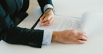 Buy stock photo Cropped shot of a businessman filling out paperwork at a desk in a modern office