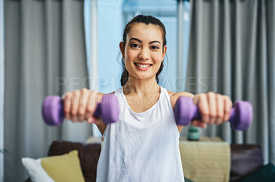 Buy stock photo Portrait of a young woman exercising with dumbbells at home