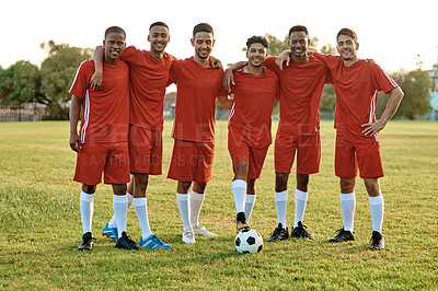 Buy stock photo Shot of a group of young soccer players standing together on a sports field