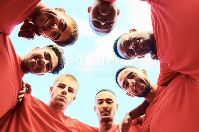 Buy stock photo Shot of a team of soccer players standing together in a huddle